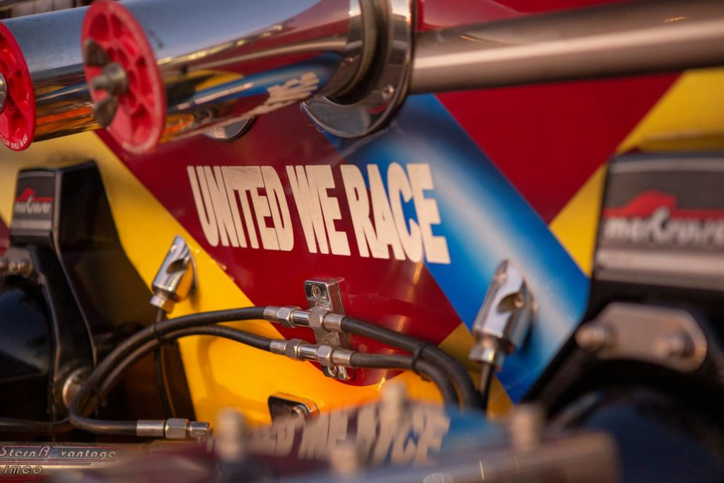 United We Race painted on boat